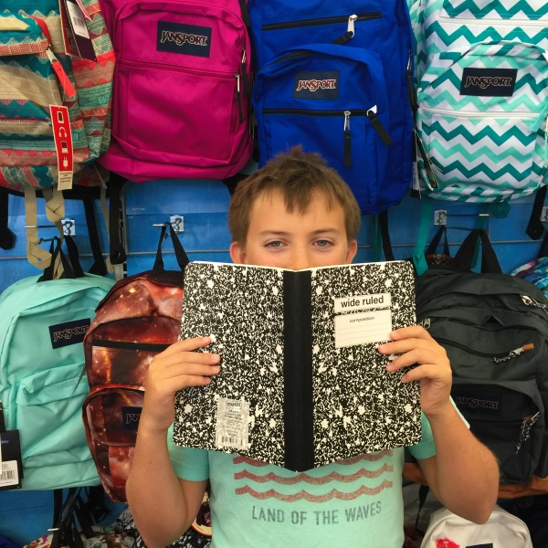Kid shopping for school supplies